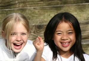 Close up of face of happy children while smiling /laughing and playing together